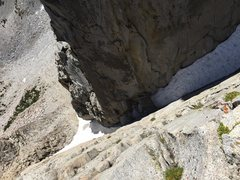 Rock Climbing Photo: Downclimbing to bypass the snowy gully.  Up high i...