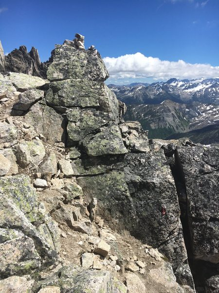 If there are too many parties on Northeast ridge and you need to bail you can repel down the Crescent bugaboo col. Here is a picture of the top anchor. There are four repels down to the glacier that can be done with the 60 m