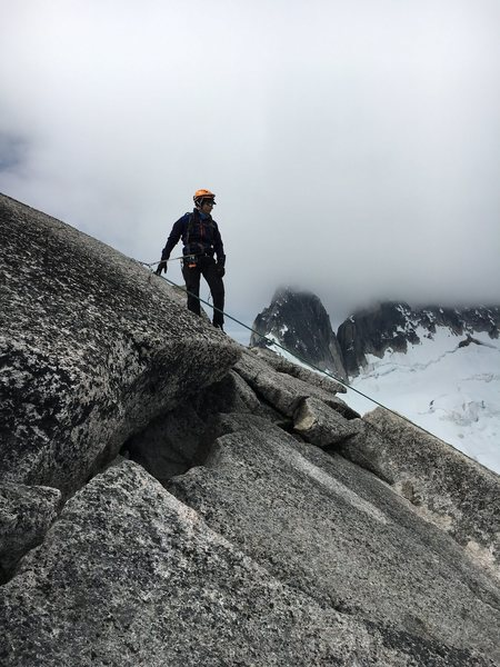 bolted anchor on the main summit. Either a double rappel or Two single rappels with a 60 m rope should get you back to the slabs. The second is also bolted