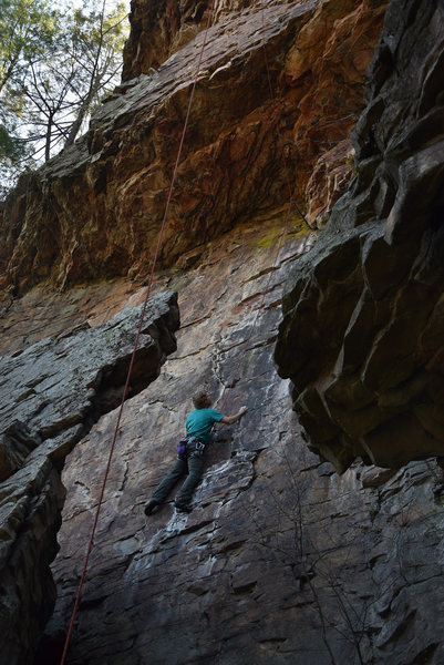 Fantastic face climbing beneath the main over look, WARNING: without placing gear under the lower roof to redirect the top-rope a fall will very likely result in the climber slamming into the fin of rock that's behind them.  North East Area