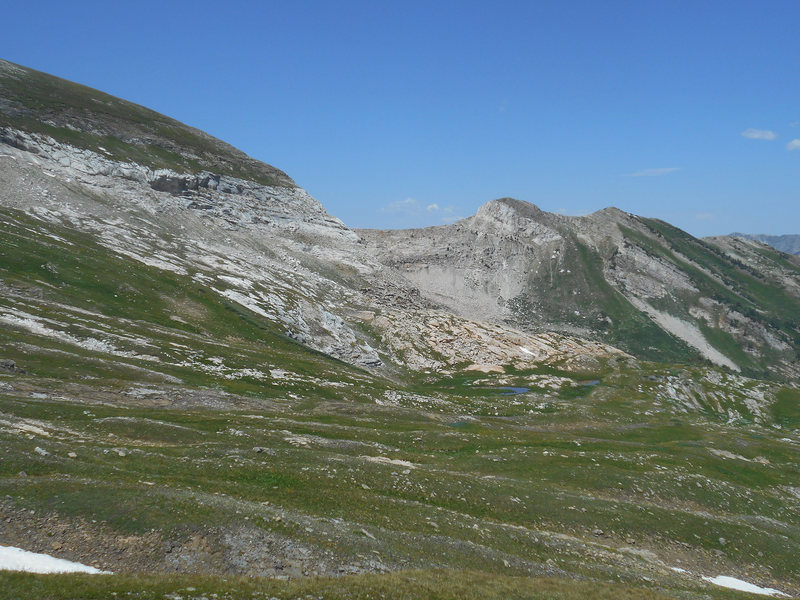 The first pond you pass in Bear Basin.  The chimneys are on the ridge connecting to the small peak on the right.