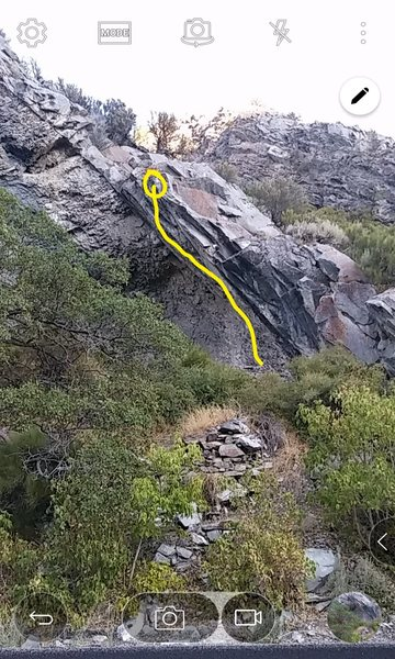 Find the stacked rock wall and the climb is right above that