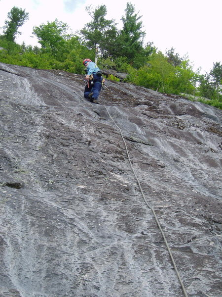 """P2 - """"Follow the easiest line""""...35-40 ft to the first bolt on P2.  RW has arrived. This is the bolt in the """"small, smooth slab""""."""