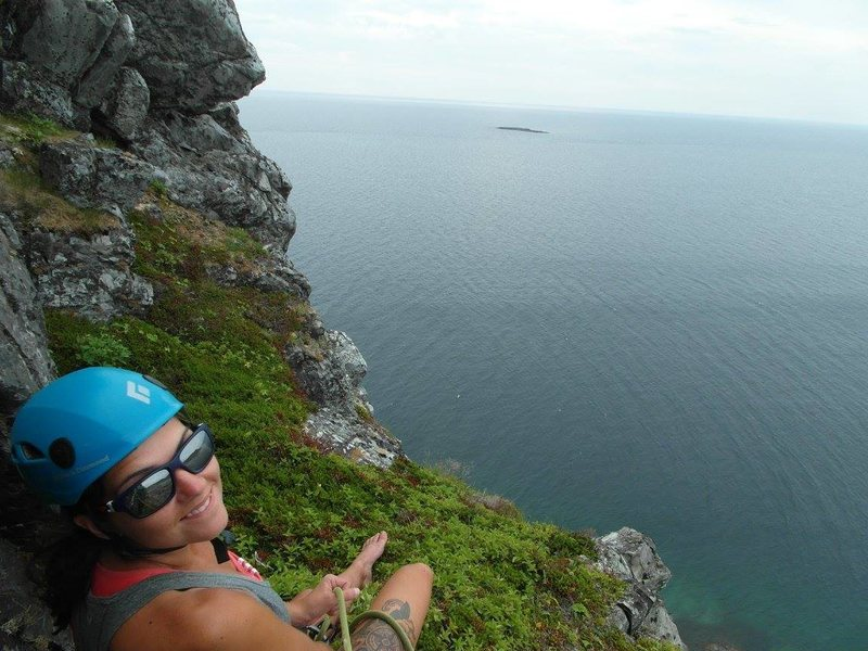 Amanda enjoying the very comfortable belay station with great views