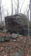 The far side of the boulder.