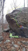 The Alcove Boulder. <br /> <br />Yellow: The Alcove Arete, ~V2. <br />Green: The Alcove quick exit, ~V2+.