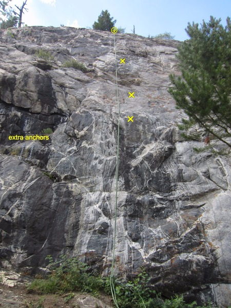 The extra anchors left of the route. The first 3 bolts are marked.