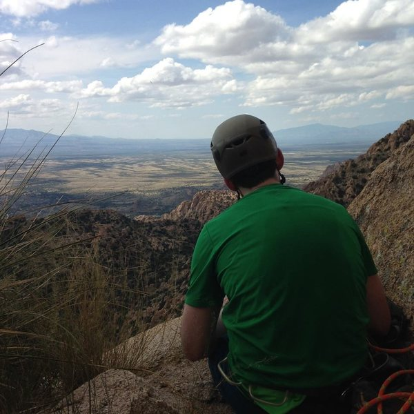 Admiring the view from the ledge at the top of pitch 4 on Ewephoria.