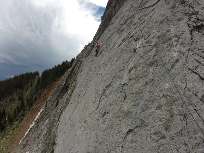 Bolting the the traverse (Pitch 4).