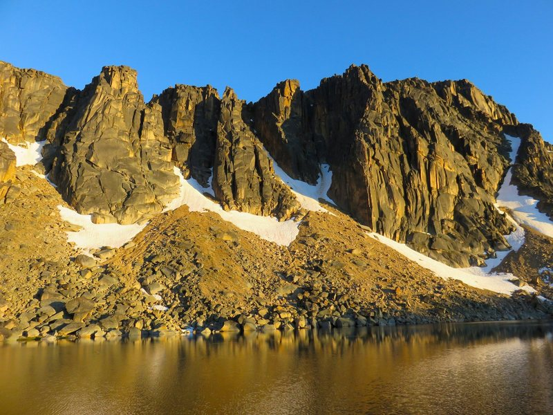 Crags of Amphitheater Mountain above Upper Cathedral Lake. Ka'aba Buttress on left, Middle Finger Buttress on right.