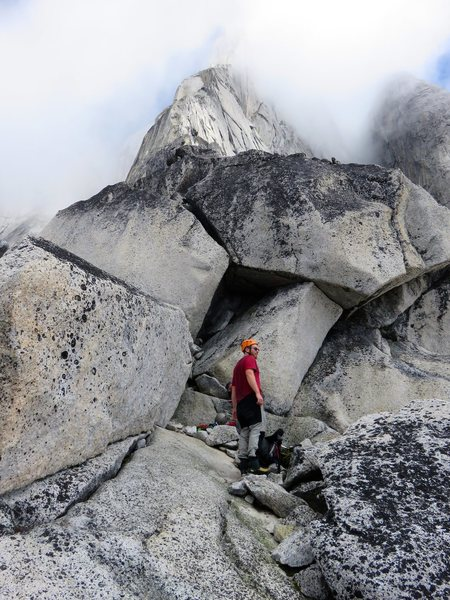 At the split boulders which mark the start of the roped climbing.