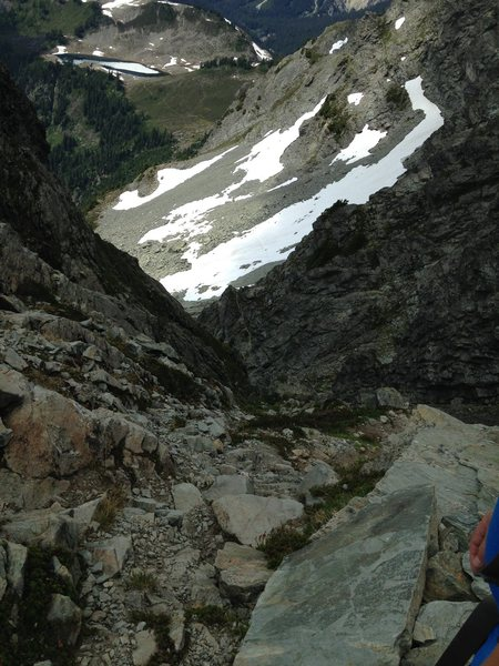"""Looking down from the top of the Chimney. You can see the scree/snow slope leading to the top of the """"grassy/rocky knoll"""""""