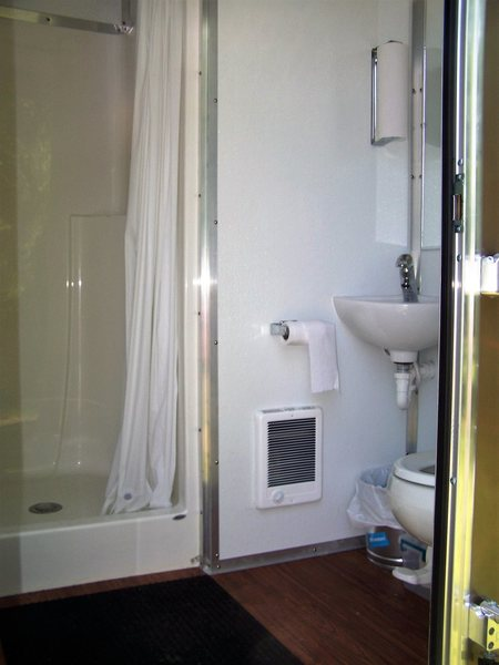 inside view of your private use shower and toilet, sink area.