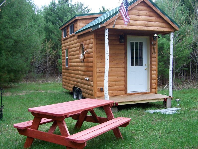 another view of our Tiny House&@POUND@39@SEMICOLON@, with its outdoor shower and new picnic table, firecircle and cooking grill.