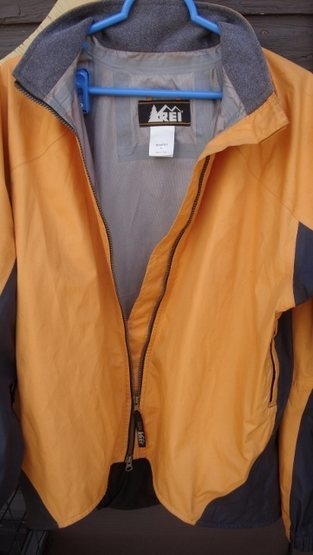 Double pull zipper with draft flap and a fleece lined collar.
