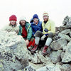 The first ascent party with friends on the summit - dressed in era-appropriate duds (L to R: Larry Coats, Joe Sharber, Gloria Hardwick, and Ross Hardwick).