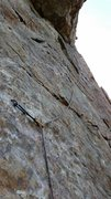 Rock Climbing Photo: Traversing out from under the roof, the second hal...