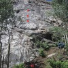 Cool Colorado Rain in red, with the 1st 3 bolts marked.<br> (Tim is rappelling Rolling in Your Arms.)