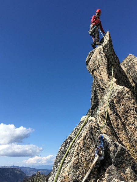 On the final fin traverse to the top of Aasgard Sentinel. Final pitch is shared by Acid Baby and The Valkyrie. Photo by Janet Arendall.