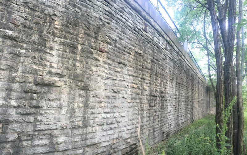Woods Wall! located far back on the West Wall.<br> Problems and routes are identified on this wall by the &quot@SEMICOLON@Pillars&quot@SEMICOLON@ and &quot@SEMICOLON@Fence sections&quot@SEMICOLON@ at the top of the wall. Check the photo of the &quot@SEMICOLON@West Wall&quot@SEMICOLON@ for more details on the system of finding routes and problems.