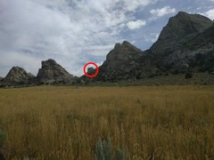 Picture of the White Lightning crag taken from the twin track dirt road facing North East.