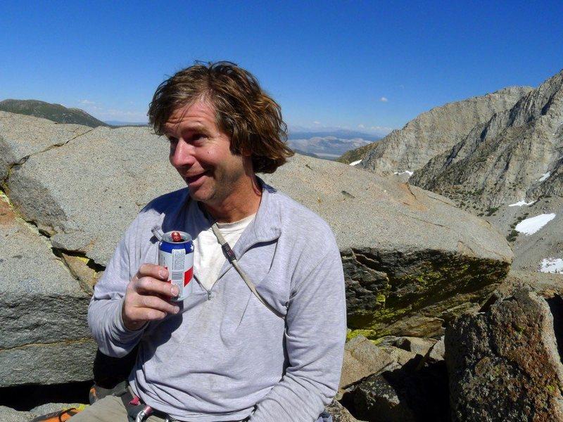 "Eric Gabel on the summit of the Sphinx celebrating the FA of ""The Great Googley Boogley"" (II 5.10). Photo: E. Hartouni"
