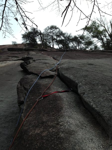 Follow the rope line for the route we climbed on U-slot.  He climbed through the low spot between the two ropes.