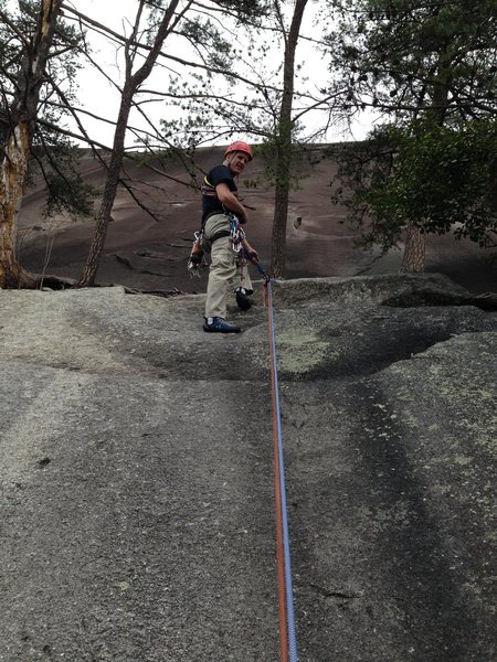 Rap station from the tree ledge to the base.  Two ropes required.  Rings are left of Entrance Crack.