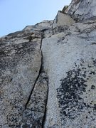 Rock Climbing Photo: 10c thin hands splitter at the start of Pitch 2.