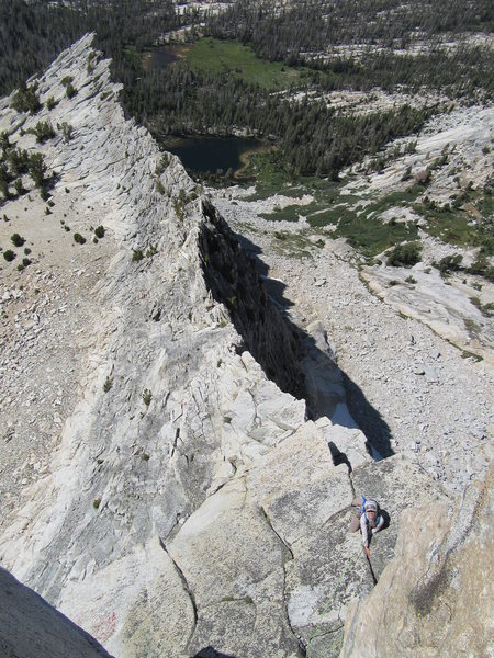 The classic pic. NB approaching the crux on the upper arete.
