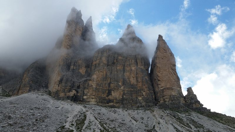 With a slightly better forecast, we managed to climb the famous Spigolo Giallo &quot@SEMICOLON@Yellow Edge&quot@SEMICOLON@ at Tre Cime. A very nice 13 pitch route.  Cime Piccola di Laveredo , The amazing tower on the left.Dolomites, Italy with Mike C, and Doug D. July 18th - August 4th, 2016.