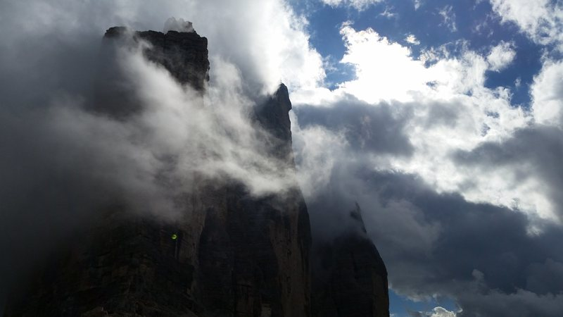 """With a slightly better forecast, we managed to climb the famous Spigolo Giallo """"Yellow Edge"""" at Tre Cime. A very nice 13 pitch route.  This is a view of the whole group in the clouds from the pass - on my hike down from our climb."""