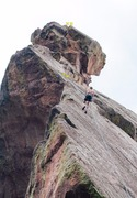 Rappel 80 feet west from the summit to a pair of eye bolts, and then rappel another 80 feet West/NW to the ground.