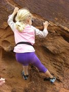 Olivia bouldering at Big Bend, Moab.