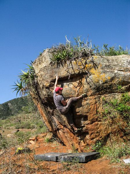 Rock Climbing Photo: Small crimp and a big heel hook.