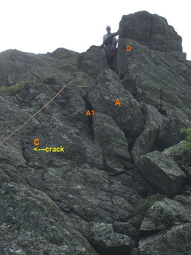 Route Photo 3: Top of P2 - The Chimney-Crack, key feature of the route. (In this photo the lower part of the v-chimney is obscured by lower ledges.)