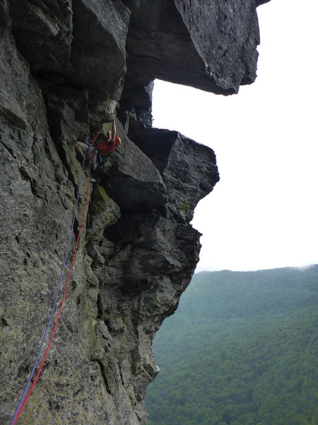 Tom leading the crux 4th pitch in the rain.
