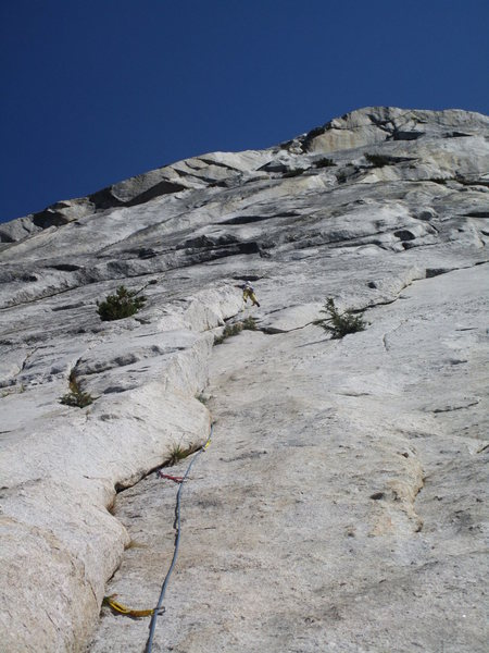 Tom Rogers near the top of the climb. The rappel anchors are shared with Garden Party and are located on top of the Garden Party buttress.