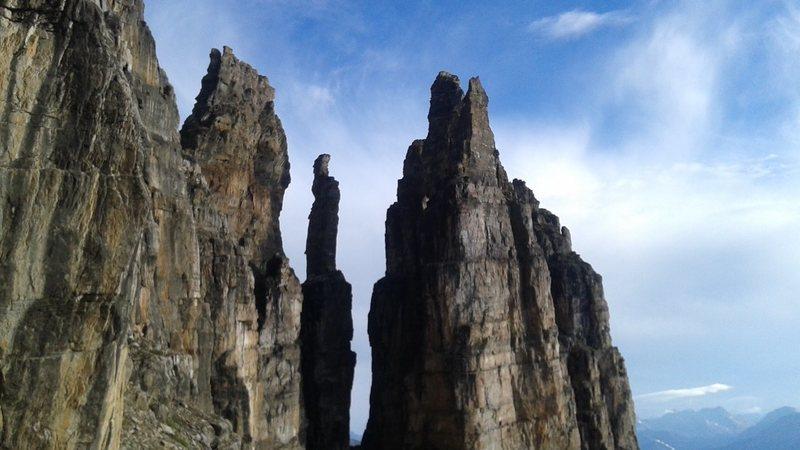 Slender towers along the base of the face.  Unclimbed?
