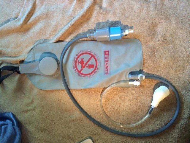 2 liter dirty water bag with filter and faucet adapter.