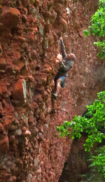 Wolfe climbs the big cobbles of<br> Slope-oke (5.11)