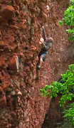 Rock Climbing Photo: Wolfe climbs the big cobbles of Slope-oke (5.11)