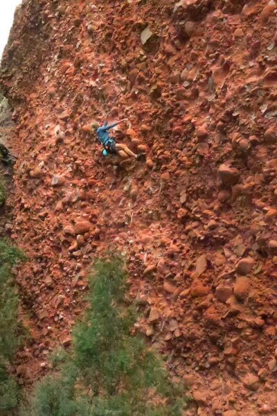Susan makes big reaches below the crux-<br> Slopy Seconds (5.11c/d)
