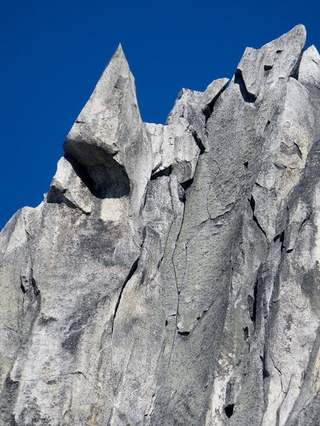 A zoomed-in view of Pitch 5 (10b) of Dairyland (5p, 10d) on South Nesakwatch Spire. Climb 40m of awesome splitters to the ridge crest.