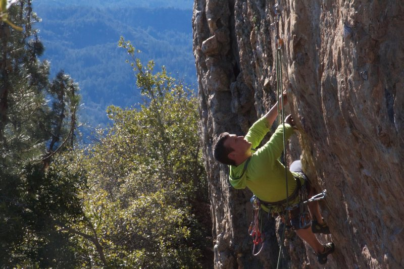 Unknown climber from Colorado working out the moves.