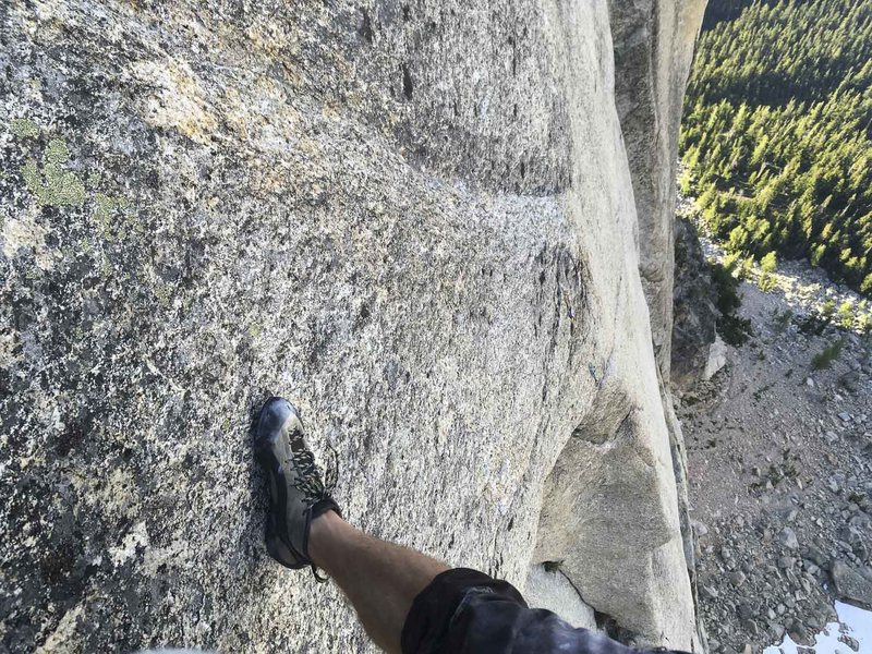 Looking down at pitch 8,  the holdless 5.13- crimp fest.