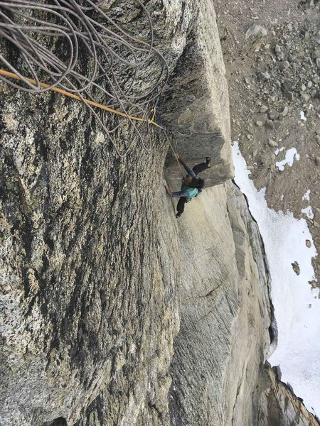 Stemming over the roof on pitch 5.