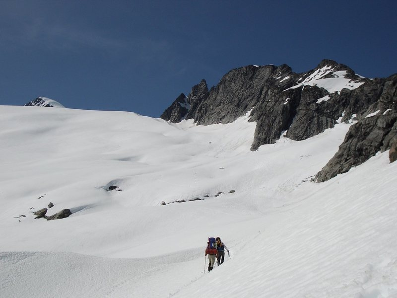 View up the snowfield. The summit slope is visible in the top left.