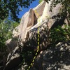 The start of Bartleby, as seen from below. Gain the slab and head into the corner, pulling the overhang on the left crack.