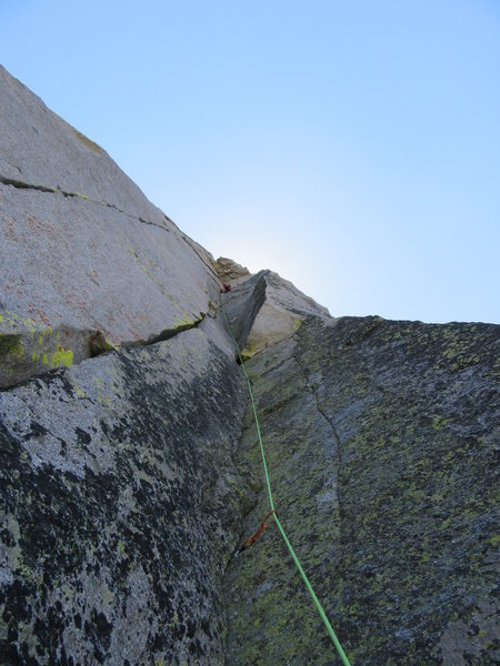 Looking up the awesome P10 of the Edge of Time Arete, Ken Kreis at the belay. Best pitch on the route.